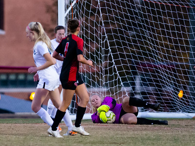 November 2, 2019 - Quince Orchard Goalkeeper Katie Orr stops this 1st half shot attempt by Churchill's Lauryn Gladd. Churchill later put two goals past Orr to advance in the state playoffs. Photo by Mike Clark/The Montgomery Sentinel