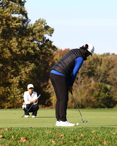 George P. Smith/The Montgomery Sentinel    Richard Montgomery's Emma Chen (right) puting on 18 as Churchill's Kaylin Yeoh looks on iin the Girls 3A/4A Classification of the 2019 MPSSAA Golf Championships played at the University of Maryland Golf Course in College Park, MD.