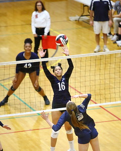 George P. Smith/The Montgomery Sentinel    Magruder's Maya Scott (16) goes up to block against Bel Air.