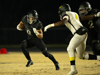 November 15, 2019 - Northwest Running Back Joseph Bruno plans his run around Richard Montgomery's Shazali Audu. Bruno and the Jaguar running game helped propel them to a 4A Quarterfinal game. Photo by Mike Clark/The Montgomery Sentinel