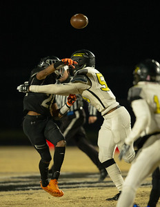 November 15, 2019 - Richard Montgomery Rocket Defensive Linemen Tristan Bell forces an early throw by Northwest's BJ Howard. This was one of the few stops on the Jaguar's that advance in the 4A playoffs with a 42-3 win. Photo by Mike Clark/The Montgomery Sentinel