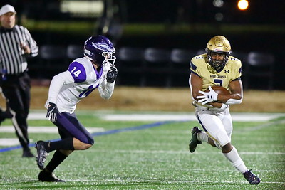 George P. Smith/The Montgomery Sentinel    Good Counsel's Sy'Veon Wilkerson (3) moves the ball to the outside in anticipation of a tackle.