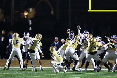 George P. Smith/The Montgomery Sentinel    Good Counsel's Vincent Errigo (36) is able to get the PAT just over the outstretched hand of a Gonzaga lineman off the hold by Ben Cuellar (12).