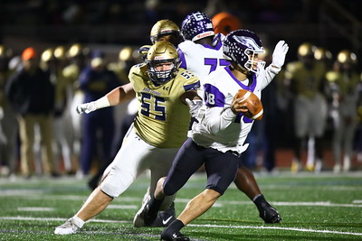 George P. Smith/The Montgomery Sentinel    Good Counsel's Brandon Roberts (55) descends on Gonzaga's quarterback Caleb Williams (18).