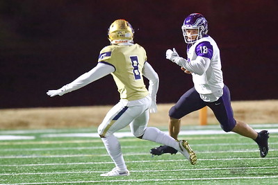 George P. Smith/The Montgomery Sentinel    Gonzaga's Caleb Williams (18)  running the ball as Good Counsel's Jalen McNair (8) looks to stop him.