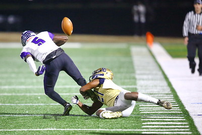 George P. Smith/The Montgomery Sentinel    After Gonzaga's Aaron Turner (5) makes the catch, Good Counsel's Nicolas Ware (21) forces a fumble which fell harmlessly out of bounds securing a gain for the Eagles.