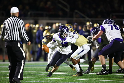 George P. Smith/The Montgomery Sentinel    Despite the facemask by Good Counsel's Mitchell Melton (17), Gonzaga's quarterback Caleb Williams (18) escaped to make a throw downfied.