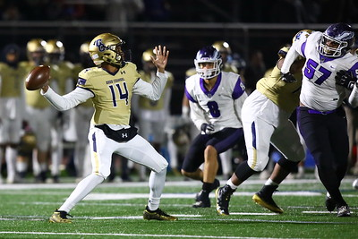 George P. Smith/The Montgomery Sentinel    Good Counsel's Chase Williams (14) cranks back for a deep throw.