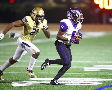 George P. Smith/The Montgomery Sentinel    Good Counsel's Nicolas Ware (21) chases Gonzaga's wide receiver Aaron Turner (5) as he advances the ball after a catch.