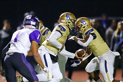 George P. Smith/The Montgomery Sentinel    Good Counsel's Chase Williams (14) handing off to Sy'Veon Wilkerson (3) as Gonzaga's DB Kye Holmes (1) rushes from the outside.