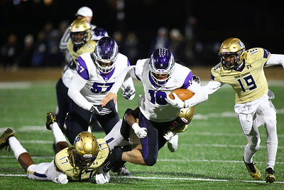 George P. Smith/The Montgomery Sentinel    Good Counsel's Mitchell Melton (17) and Jason Moncure (22) catch Gonzaga's scrambling quarterback, Caleb Williams (18), from the back.