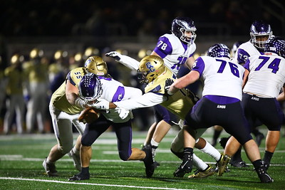 George P. Smith/The Montgomery Sentinel    Gonzaga's quarterback Caleb Williams (18) gets sacked by Good Counsel's Brandon Roberts (55) and Mitchell Melton (17).