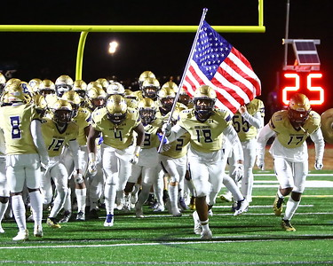 George P. Smith/The Montgomery Sentinel    Good Counsel taking the field against Gonzaga carrying the US flag.