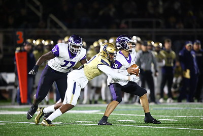 George P. Smith/The Montgomery Sentinel    Good Counsel's beats Gonzaga's Olu Fashanu (77) to get to Caleb Williams (18) and a sack.