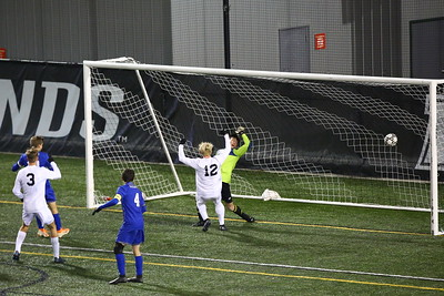 George P. Smith/The Montgomery Sentinel    Walt Whitman's Ian Poe (8), striking off a free kick from outside the frame, puts his kick past Leonardtown's goalie, JR Gawel (99), for the Vikings' 3rd and final goal.