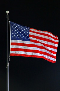 George P. Smith/The Montgomery Sentinel    US Flag shows that a brisk breeze was blowing over the Loyla's Ridley Intercollegiate Athletic Complex during the State soccer finals.