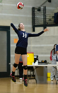 November 16, 2019 - Sarah Schaupp of Magruder serves up a winning point in route to the 3A state championship against the Northern Patriots at the University of Maryland's Ritchie Collesium. Photo by Mike Clark/The Montgomery Sentinel