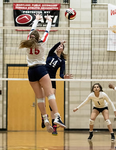 November 16, 2019 - Sarah Schaupp of Magruder spikes the ball past Northern's Allie Droneberger to earn one of their championship points in the Maryland 3A finals. Photo by Mike Clark/The Montgomery Sentinel