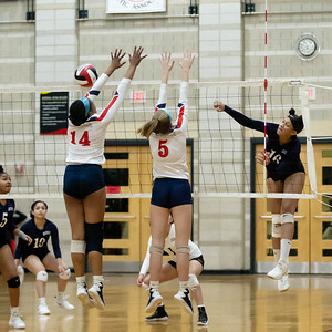 November 16, 2019 - Maya Scott of Magruder puts away this shot against Northern's Chantele McCray (14() and Karoline Kampsen (5). Magruder took down volleyball powerhouse Northern 3 sets to 1. Photo by Mike Clark/The Montgomery Sentinel