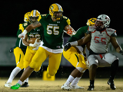 November 22, 2019 - Top national recruit Brian Bresee clears the way for Damascus Running Back Chris Shaw. The Damascus ground game helped the defending state champions advanced to the 2019 state semi-finals over Franklin. Photo by Mike Clark/The Montgomery Sentinel