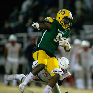 November 22, 2019 - Franklin's Deon Houston cannot stop Damascus Fullback Marcel Mami as the  hosts Hornets dominate the line of scrimmage in the 30-13 3A state quartfinals victory. Photo by Mike Clark/The Montgomery Sentinel
