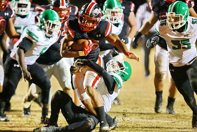 George P. Smith/The Montgomery Sentinel    Quince Orchard's Ryan Jones (26) powers through Arundel defenders for the Cougars 3rd touchdown.