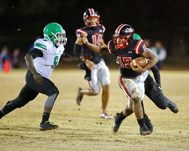 George P. Smith/The Montgomery Sentinel    Quince Orchard's Marquez Cooper (15) getting ready to stiff arm Arundel's Ashalli Cannon (9).