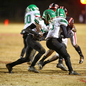 George P. Smith/The Montgomery Sentinel    Arundel's Ethan Facey (23) carrying the ball against QO.