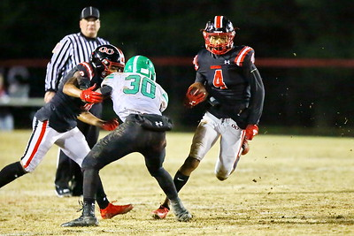 George P. Smith/The Montgomery Sentinel    With Quince Orchard Larry Hackey (8) tying up Arundel's Jordan Andrews (3), William Simpkins (4) cuts inside.