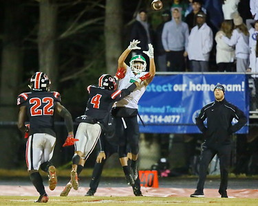 George P. Smith/The Montgomery Sentinel    Quince Orchard's William Simpkins (4) might be there a tad early as Arundel's Shaun-Trent Okoyo (7) goes up for a catch.