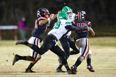 George P. Smith/The Montgomery Sentinel    Bermuda grass goes flying as Arundel's Jean Seka (29) tries to catch Quince Orchard's Marquez Cooper (15).