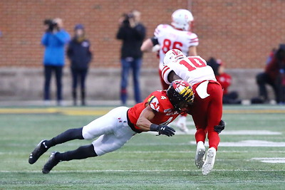 George P. Smith/The Montgomery Sentinel    Maryland's Keandre Jones (4)  makes a diving tackle on Nebraska's JD Spielman (10).