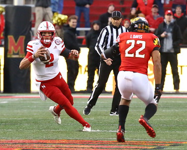 George P. Smith/The Montgomery Sentinel    Nebraska quarterback Adrian Martinez (2) tries to cut back in reaction to Maryland's Isaih Davis (22) as he scrambles out of the pocket.