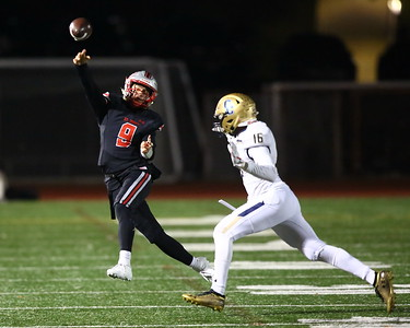 George P. Smith/The Montgomery Sentinel    St. John's Sol-Jay Maiava (9) rolls out of the pocket with Good Counsel's Ronnell McCorn (16) in tow during the WCAC Championship game played at Catholic University on Sunday, November 24, 2019.