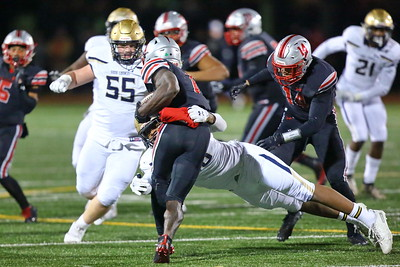 George P. Smith/The Montgomery Sentinel    Good Counsel's Kristopher Jenkins (18) tackles St. John's Rakim Jarrett (1) during the WCAC Championship game played at Catholic University on Sunday, November 24, 2019.