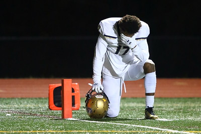 George P. Smith/The Montgomery Sentinel    Good Counsel's Mitchell Melton (17) in a moment of private reflection before the start of the WCAC Championship game against St. Johns played at Catholic University on Sunday, November 24, 2019.