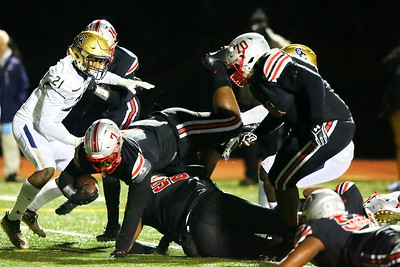 George P. Smith/The Montgomery Sentinel    St. John's Antwain Littleton (7) dives over his own lineman for the Cadets 1st touchdown against Good Counsel in the WCAC Championship played at Catholic University on Sunday, November 24, 2019.