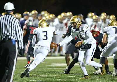 George P. Smith/The Montgomery Sentinel    Good Counsel's Chase Williams (14) handing off to Sy'Veon Wilkerson (3) during the WCAC Championship game against St. Johns played at Catholic University on Sunday, November 24, 2019.