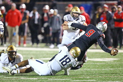 George P. Smith/The Montgomery Sentinel    Good Counsel's Kristopher Jenkins (18) makes a diving tackle on St. John's quarterback Sol-Jay Maiava (9) during the WCAC Championship game played at Catholic University on Sunday, November 24, 2019.