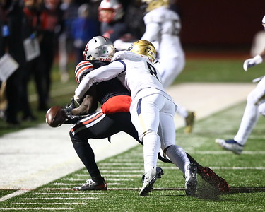 George P. Smith/The Montgomery Sentinel    Good Counsel's Jalen McNair (8) breaks up the Sol-Jay Maiava pass to St. John's Rakim Jarrett (1) during the WCAC Championship game played at Catholic University on Sunday, November 24, 2019.