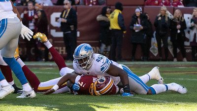 November 24, 2019 - The Detroit Lions' Jarrad Davis takes down Redskins Quarterback Dwayne Haskins but not before Haskins completed this pass. Haskins led his team to the 19-16 victory by completing 13 or 29 passes for 156 yards. Photo by Mike Clark/The Montgomery Sentinel