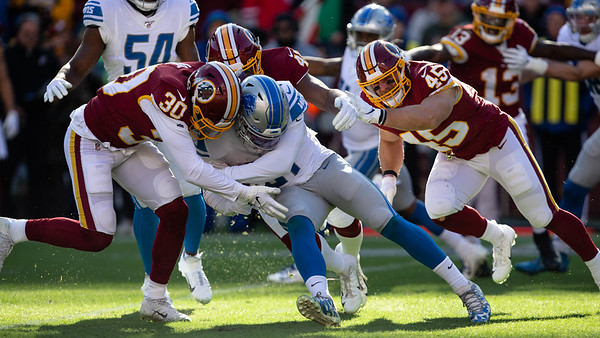 November 24, 2019 - Detroit Lions' Returner Ty Johnson runs square into the Redskin defense on this return. Three interceptions by the  Redskins made the difference in the 19-16 Washington win. Photo by Mike Clark/The Montgomery Sentinel