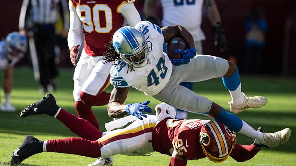 November 24, 2019 - Detroit Lions Running Back Bo Scarbrough has a big day against the Redskins with 98 yards on 18 carriers. This carry was stopped by a diving Montae Nicholson. Photo by Mike Clark/The Montgomery Sentinel
