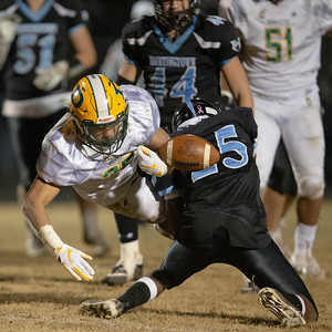 Novermber 29, 2019 - Huntingtown Defensive Back David Bolin takes down Damascus Running Back Chris Shaw and forces a fumble. Damsacus would recover and go on to cement a 3A semi-final win. Photo by Mike Clark/The Montgomery Sentinel