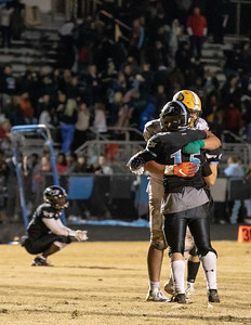 November 29, 2019 - In the name of good sportmanship, top national recruit Brian Bresee of Damascus skips the his team's semi-final victory celebration and instead helps console Huntingtown players, who's 12-0 undefeated season ended on game shy of the state championship. Photo by Mike Clark/The Montomgery Sentinel