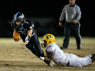 November 29, 2019 - Huntingtown Running Back Noah Kuntz fails to get away from diving Damasus Linemen Max Mesa. Photo by Mike Clark/The Montgomery Sentinel
