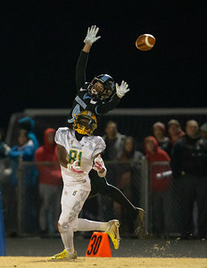November 29, 2019 - Damascus Hornet's Defensive Back Numi Ayo-Durojaiye gets position and the interception against leaping Huntingtown Wide Receiver Anthony Smith. Photo by Mike Clark/The Montgomery Sentinel
