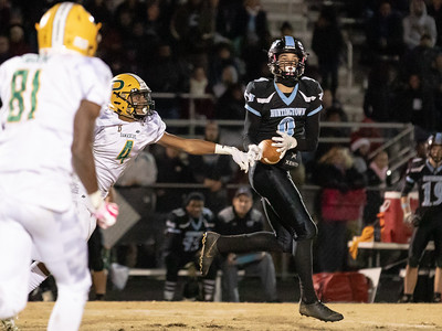 November 29, 2019 - Huntingtown Quarterback Trent Connolly and Wide Receiver Anthony Smith connect on this 95-yard touchdown pass to tie the 3A semi-final game at 14 against Damascus. Photo by Mike Clark/The Montgomery Sentinel