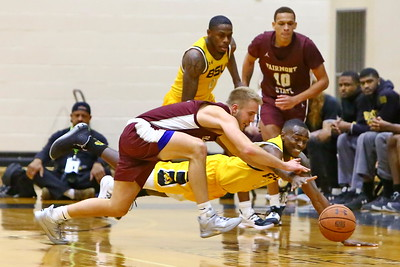 George P. Smith/The Montgomery Sentinel    Bowie State's David Belle (11) and Fairmont State's Cole VonHandorf (2) go after a loose ball and Bowie State prevailed.
