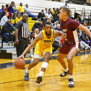 George P. Smith/The Montgomery Sentinel    Bowie State's Cameron Hayes (22) trying to turn the corner on Fairmont State's Isaiah Sanders (10).